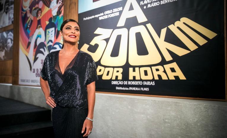 A atriz interpreta ela mesma na premiação que consagrada Alain Dutra