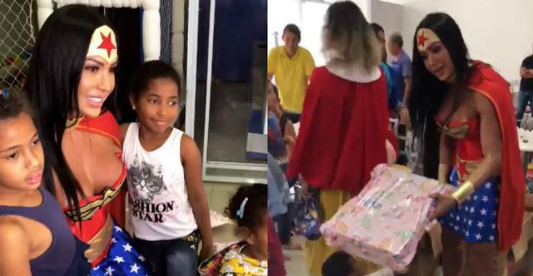 Gracyanne Barbosa se veste de 'Mulher Maravilha' e presenteia crianças carentes