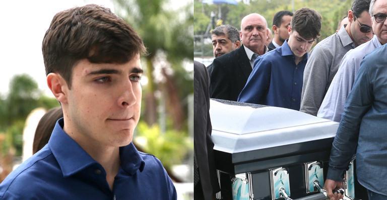 Resultado de imagem para filho de gugu chora ao carregar caixão do pai