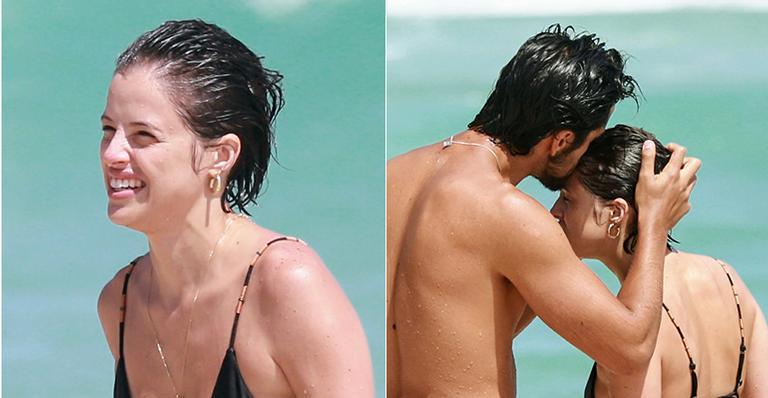 Apaixonados, casal de atores globais trocou beijos e afagos em dia de calorão